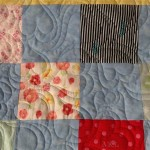 baby clothing quilt with all over hearts