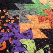 Spider webs quilted on Halloween quilt